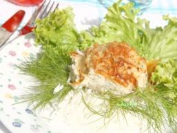 Рибні биточки, запечені в рибному соусі